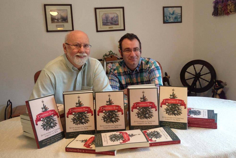 Kyle and son James Pratt with copies of Christmas in Time
