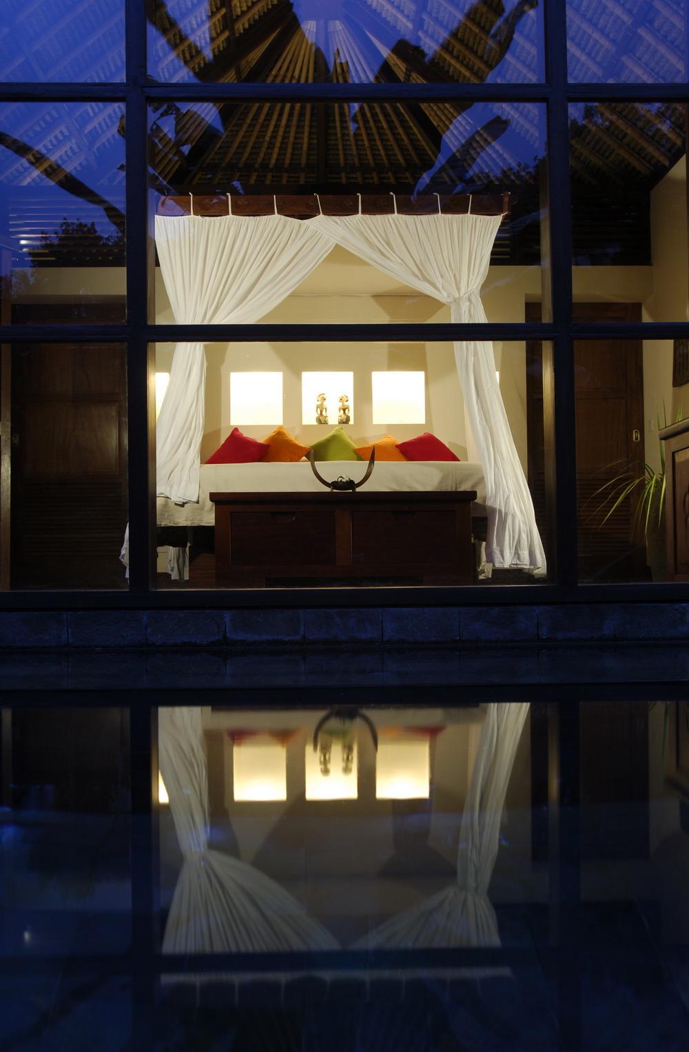All Villas - bedroom at night from pool.jpg