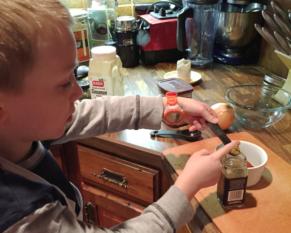 Jonathan measuring spices for Chilly Night Chili. We all loved it so much, he'll be making it for our church chili cook-off this Sunday!