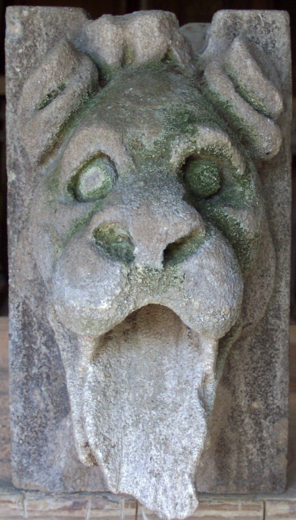 Before: Stone gargoyle with a broken tongue... Ouch!