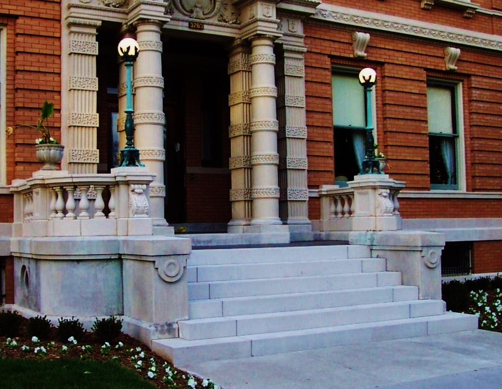After: After setting new limestone steps on a concrete foundation we restored all of the terracotta balustrade.  Lee Lindsey  Stone Works, St. Louis, MO