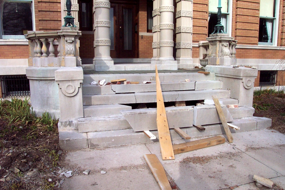 Before: This is the way another contractor left this project! The Carthage Limestone steps and terra cotta balustrade are in need of repair.