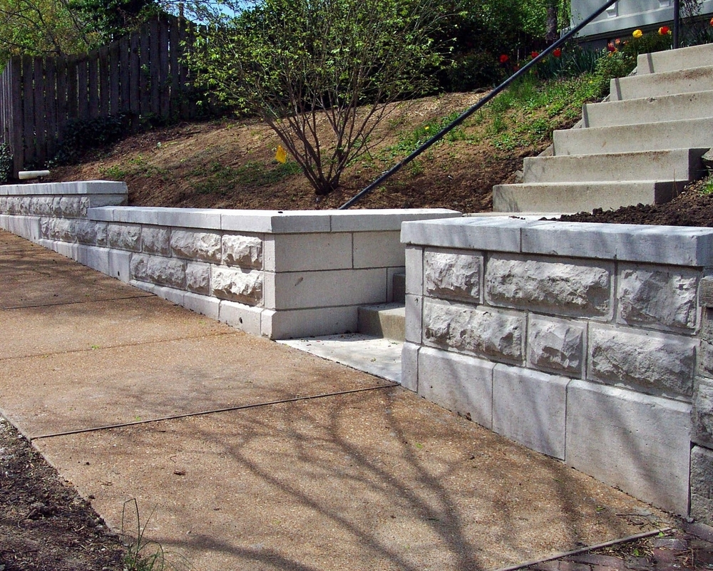 Limestone Retaining Wall replaced with new stone and set level. The stone was cut the same as the origional wall. - Stone Works - Lee Lindsey