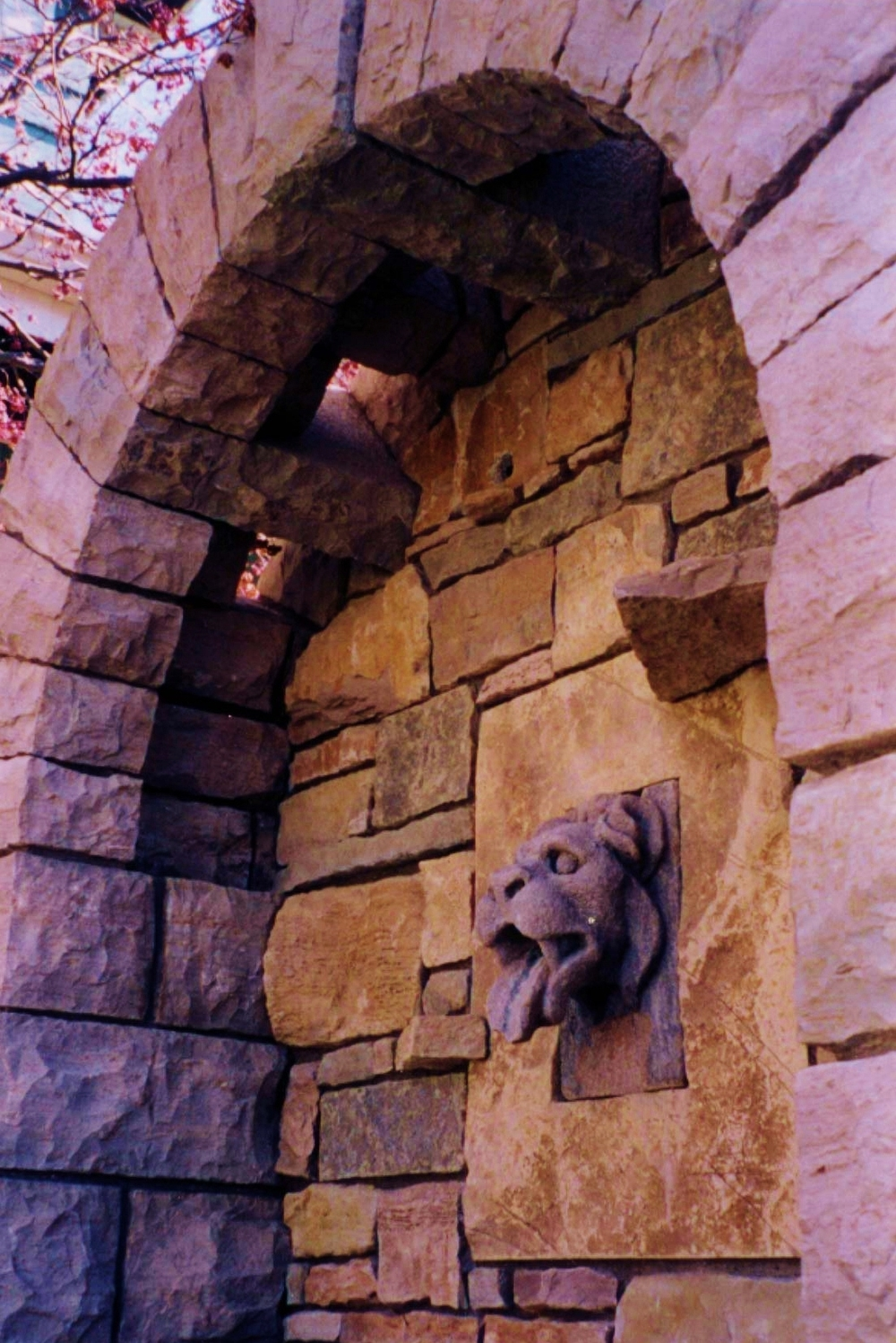 Stone arch with sky lights over a gargoyle fountain.  Lee Lindsey  Stone Works,  St. Louis, MO
