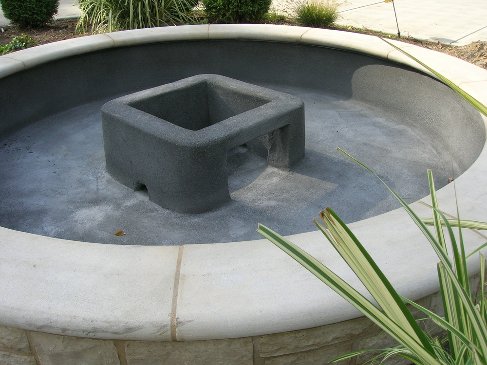 Concrete Fountain Base in a Fountain Pool