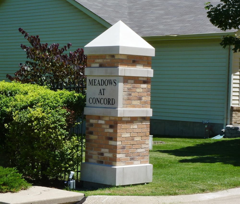 Pointed Stone Colmmn Cap on a Brick and Stone Entry Column