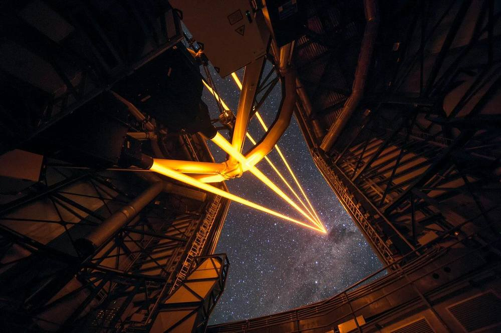 Laser guide star system at the Paranal Observatory. This spectacular image shows the four beams emerging from the new laser system on Unit Telescope 4 of the VLT.