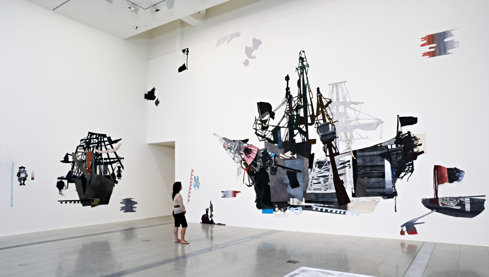 Sally Smart,  The Exquisite Pirate Oceania , 2006. Synthetic polymer paint and ink on canvas and fabric with collage elements and pins,  dimensions  variable. Installation view, The Ian Potter Centre: National Gallery of Victoria, Melbourne. Image courtesy of the artist and the National Gallery of Victoria. Photo: Graham Baring.