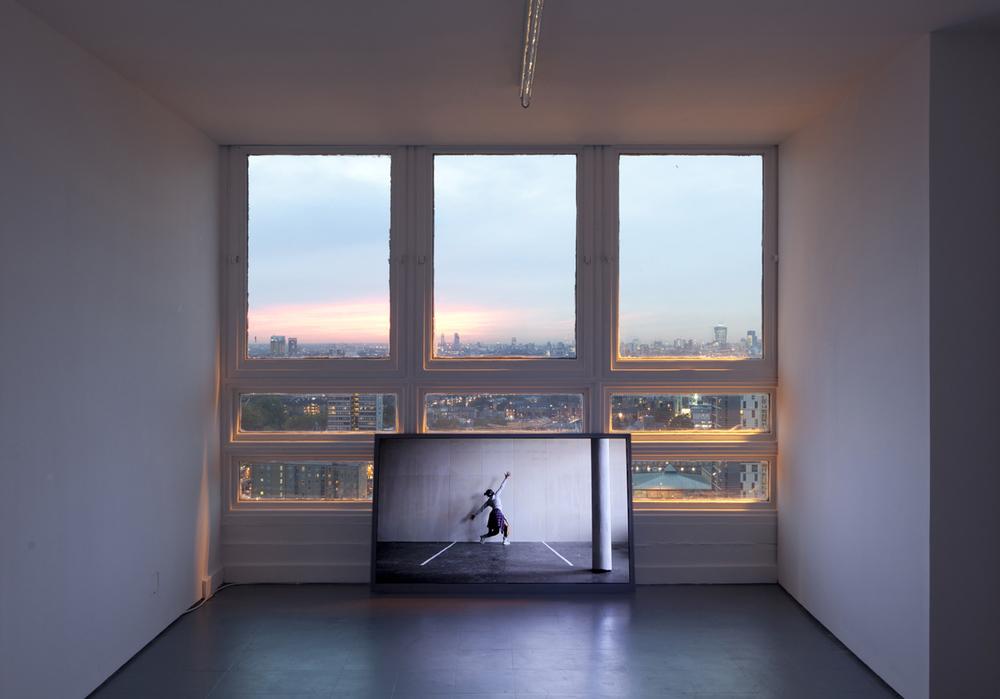 "Shaun Gladwell,  ""asynchronous pas de deux / we are listening to the same track at different times"".  2012. Digital video. 6mins 48 secs.  Videography, Wouter Van der Hallen . Dancer, Lindy Nsingo. ©"