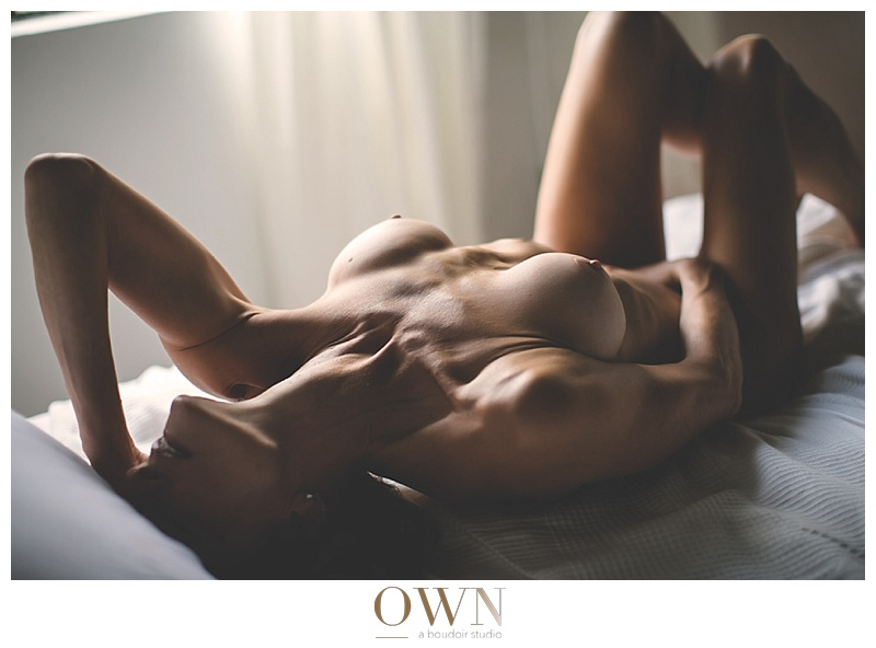 woman on a bed own boudoir atlanta boudoir