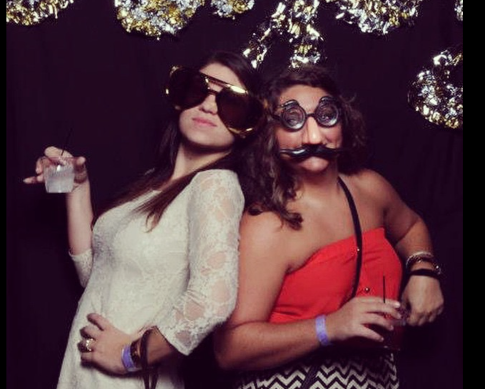 and to lighten the mood...here is a picture of my friend Lindsey and I owning a photo-booth.