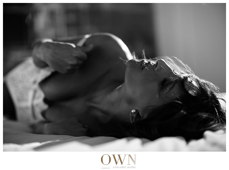 woman in bed own boudoir atlanta boudoir photographer