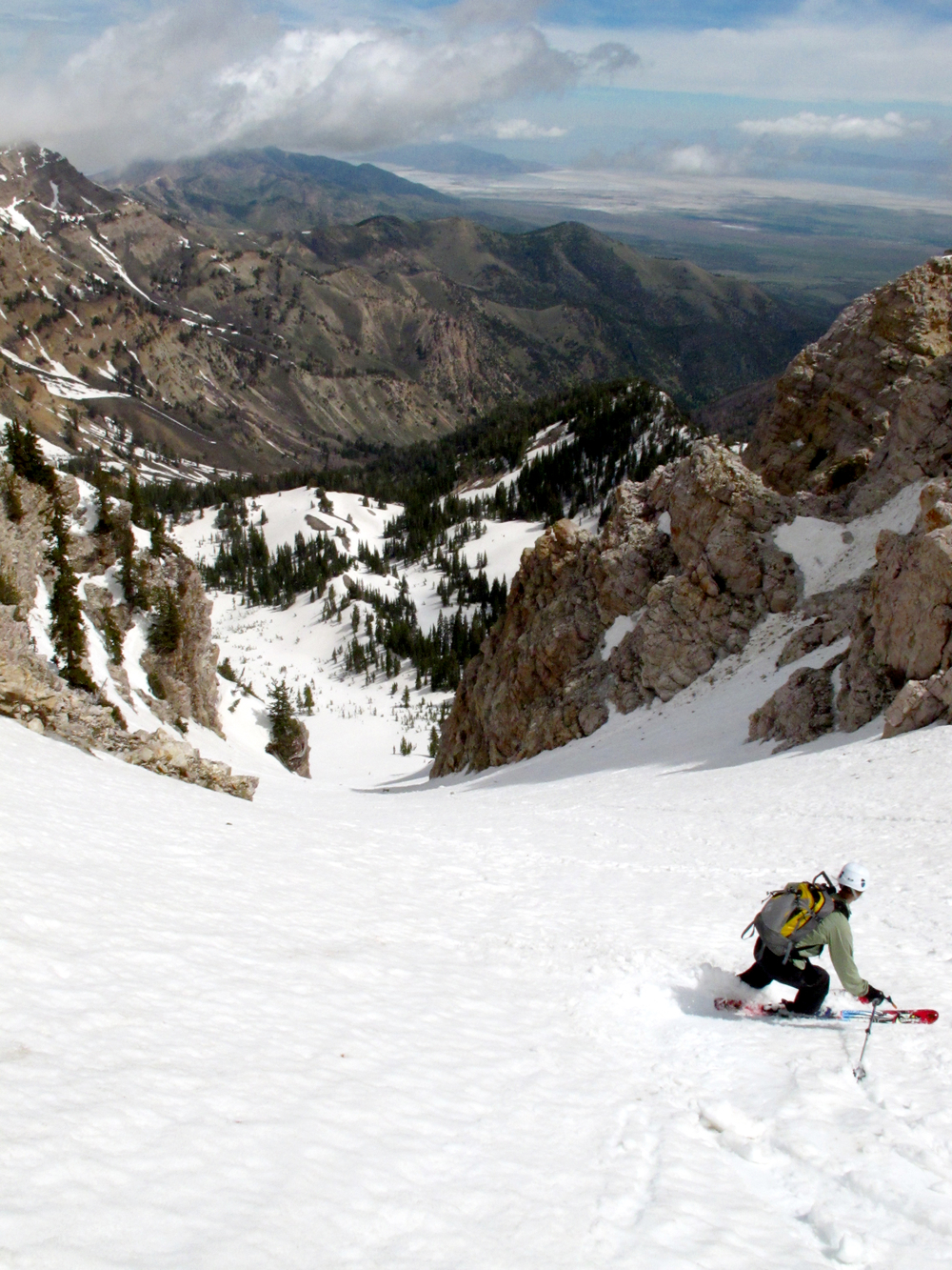 Heather , co-owner of Powderhound Marketing skis the Twin Couloirs of Deseret Peak in Utah's West Desert.