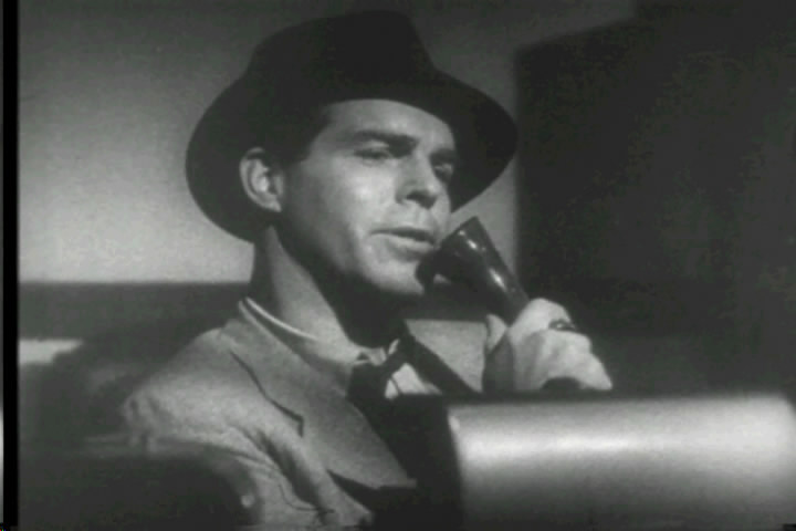 Fred MacMurray as Walter Neff, confessing into Dictaphone (Image is in public domain)