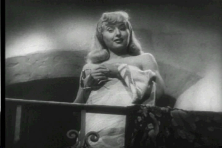 "Billy Wilder chose a cheap wig to emphasis Barbara Stanwyck's character, Phyllis Dietrichson's, ""sleazy phoniness"" (Image is in public domain)"