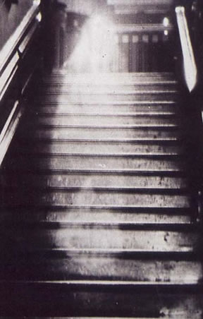ghost image on staircase Wikipedia pubdomain.jpg