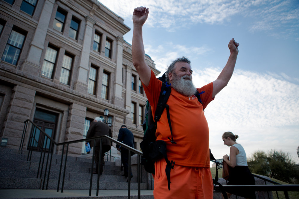 Tom Kennedy celebrates a triumphant arrival to the Texas State Capitol after spending three walks walking from Houston to Austin to raise awareness for mental health. Mar. 1, 2017.