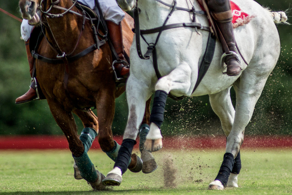 Hudspeth riding off her opponent during a match at the Hosuton Polo Club. A player's opponent can ride up next to them, called a bump or ride off, to spoil their shot or remove them from the play, but the angle of contact must be no more than 45 degrees to prevent accidents and injuries.