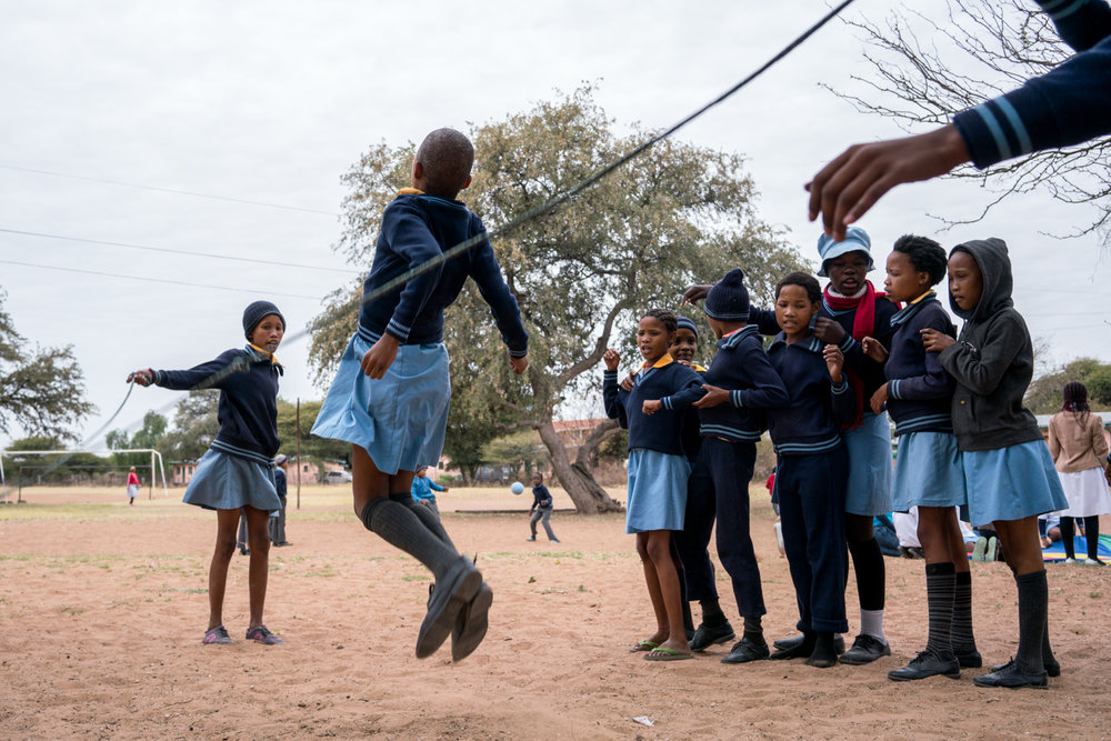 School children at the primary school in D'kar, Botswana jump rope during a field day on Aug. 4, 2017.