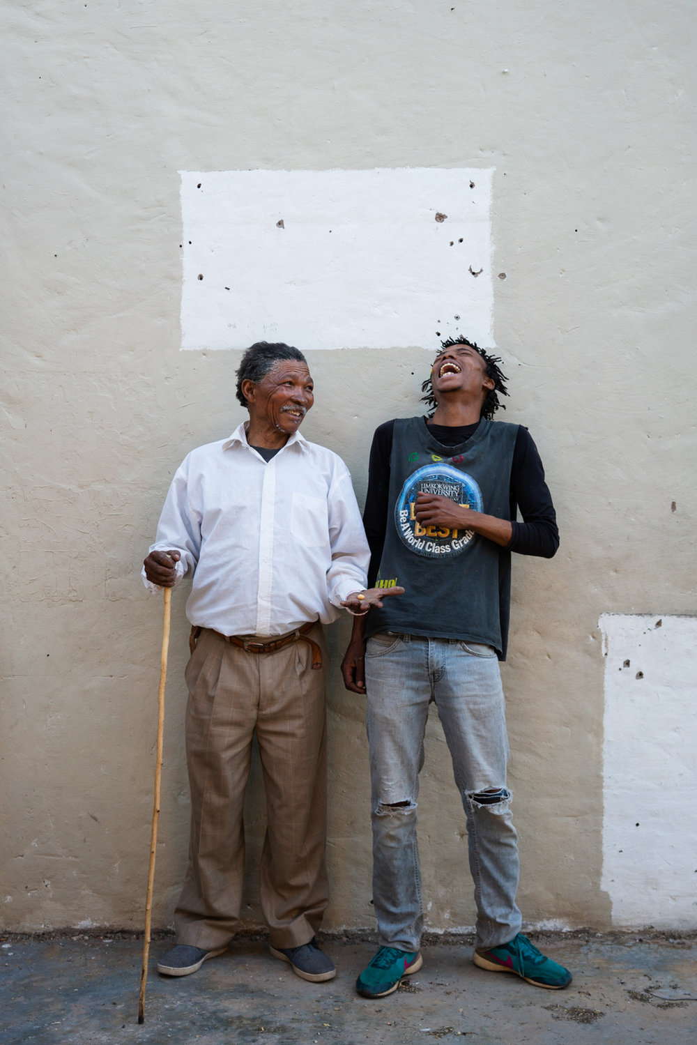 Alphynho with his grandfather Xgaiga inside of an abandoned house he recently acquired. Xgaiga intends to fix the house and property with Alphynho and turn it into a lodge.