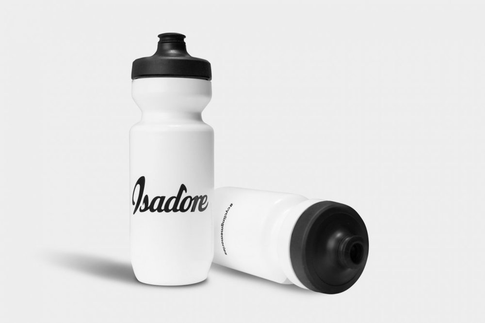 "SIGNATURE BIDON WHITE - Isadore Bidons are an oasis for long rides and on hot weather.  The Signature bidon features our logo and brand manifesto: ""Road is the way of life""."
