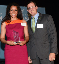 Nicole receiving her award at the GMU School of Public Policy Alumni Gala on May 30, 2013. Nicole is joined by President of the Alumni Board Brian Jones.