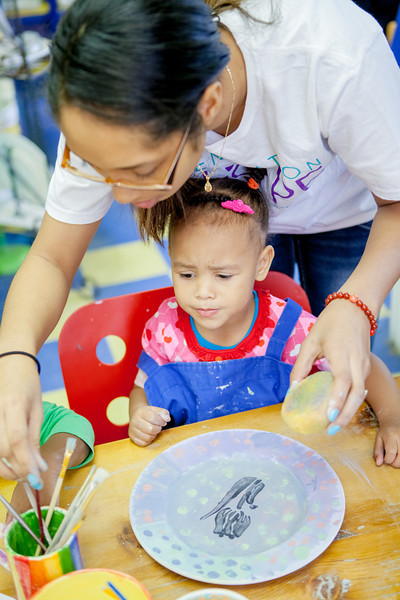 Scholar Marikit helping her daughter paint a plate during our 2013 Valentine's Day Party