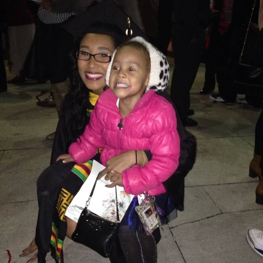 Scholar Marikit Williams with her daughter Maleah.  Marikit graduated from the University of Maryland, College Park in December 2013.