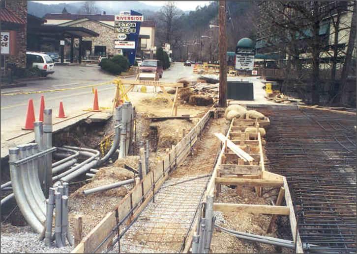 Cantilevered sidewalk being built.