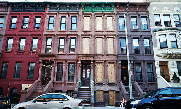 Joel Feazell and Claudia Aguirre paid $920,000 for their home-to-be on West 120th Street in Harlem. The couple are midway through a renovation. Credit: Julie Glassberg for The New York Times