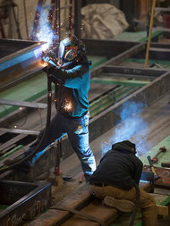 A worker in Pennsylvania welds together steel for the modular units. Credit:   Ryan Collerd for The New York Times