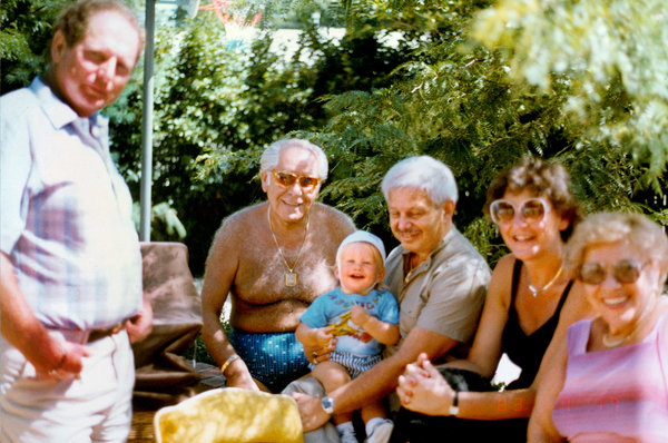 Roman Blum, shirtless, at a birthday party on Long Island in 1983. In 1949, he and his wife, Eva, moved to Forest Hills, Queens, where they joined a tightknit community of Holocaust survivors.