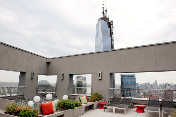 The common roof deck of W New York Downtown has open views of One World Trade Center. Credit: Emily Andrews for The New York Times
