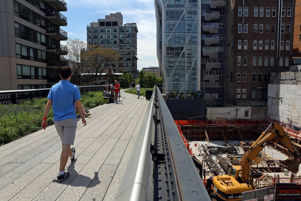 Construction has begun at 508 West 24th Street, a 10-story condo bordering the High Line park. Credit: Andrea Mohin/The New York Times