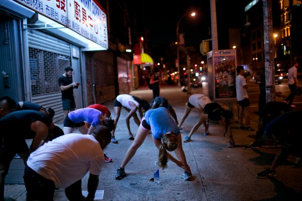 Logging Miles After Night Falls:  In the developing scene of urban running crews, socializing and drinking are a large part of the draw. Kirsten Luce for The New York Times