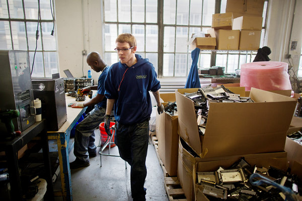 Ombligo, a technology recycling firm, in Industry City.   Victor J. Blue for The New York Times