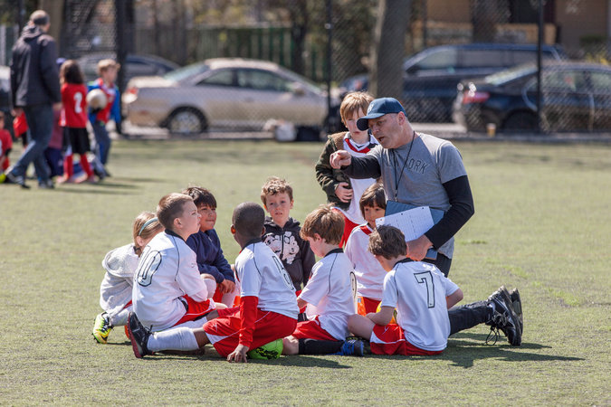 Marcel Van Ooyen with his son Jude's soccer team in Brooklyn.    Credit:  Emon Hassan for The New York Times