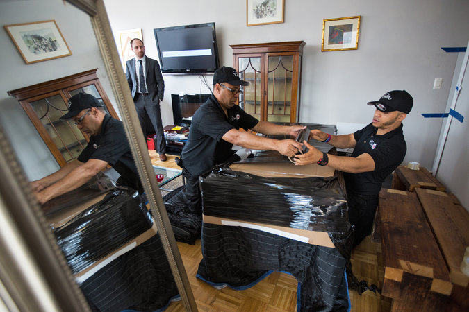 Workers from FlatRate Elite ready a Riverside Boulevard apartment for moving.      Credit  Ruth Fremson/The New York Times