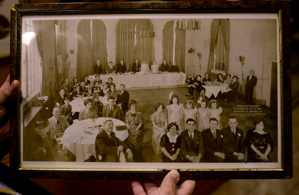 Nino Russo, who owns Gargiulo's Restaurant with his brothers, holds a wedding photo taken there in 1937