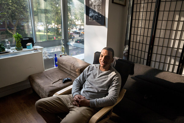 Brandon Deese in his apartment in Chelsea, which he won through a housing lottery. Credit: Richard Perry