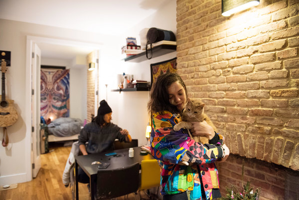 Selma Radzivonovich, 20, in the gut-renovated apartment on Bedford Avenue in Williamsburg where she lives above the unit to which Ms. Alvillar is set to return.