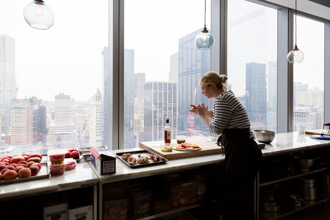 Alison Roman, senior food editor at Bon Appétit, in the test kitchen on the 35th floor of 1 World Trade Center.      Credit  Pablo Enriquez for The New York Times