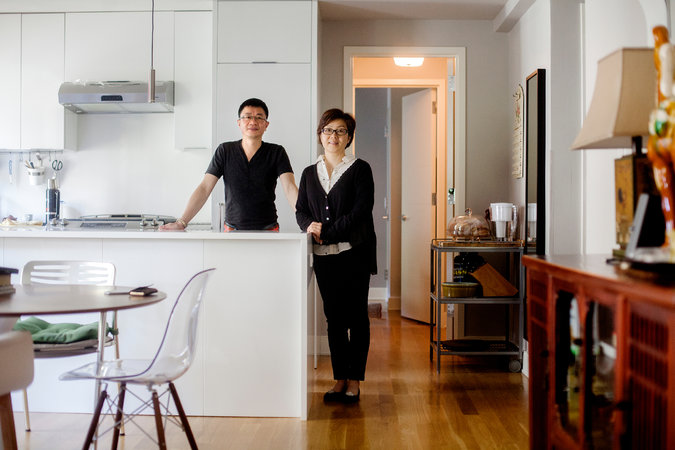 Yi Lin and his wife, Molly Xi, in their new home in Manhattan. Under a federal program known as EB-5, they received green cards in exchange for their investment in a Miami real estate project. Credit Sam Hodgson for The New York Times