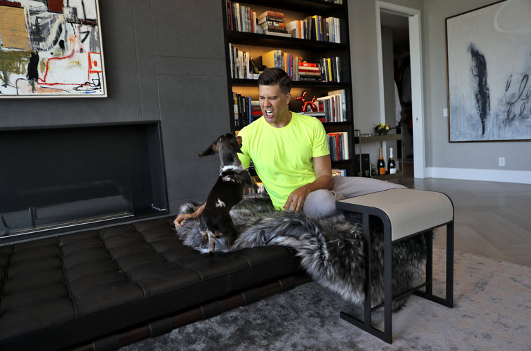 Fredrik Eklund plays with his miniature dachshunds in TriBeCa.    Credit Michelle V. Agins/The New York Times