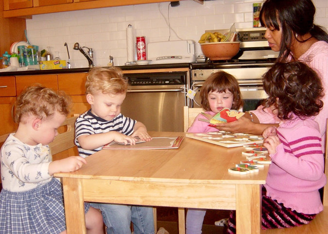 Alene Mathurin with Elizabeth and William Appel-Caraccioli, far left, on a playdate years ago in Manhattan.
