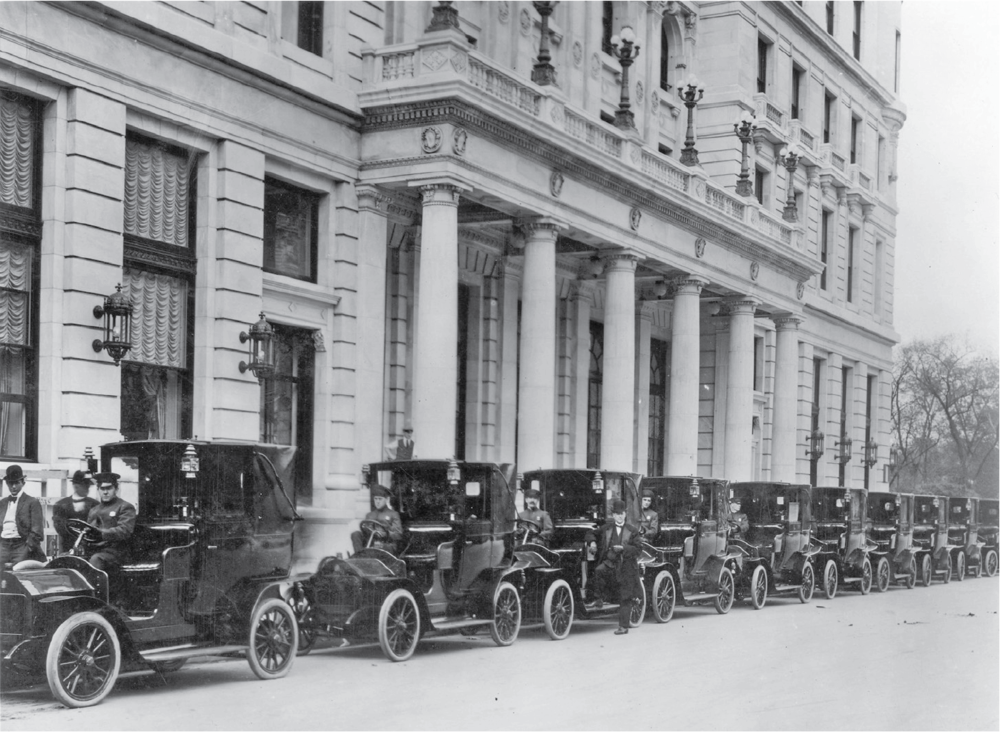 QUINTESSENTIAL NEW YORK: On the Plaza's opening day, not only was the iconic hotel introduced to New Yorkers, but so was another indispensable city accoutrement. Here, the first-ever New York City taxicabs line up along the Fifth Avenue side of the Plaza, awaiting their first passengers. It wasn't long before these taxis displaced horse-drawn hansom cabs as New Yorkers' transportation of choice.