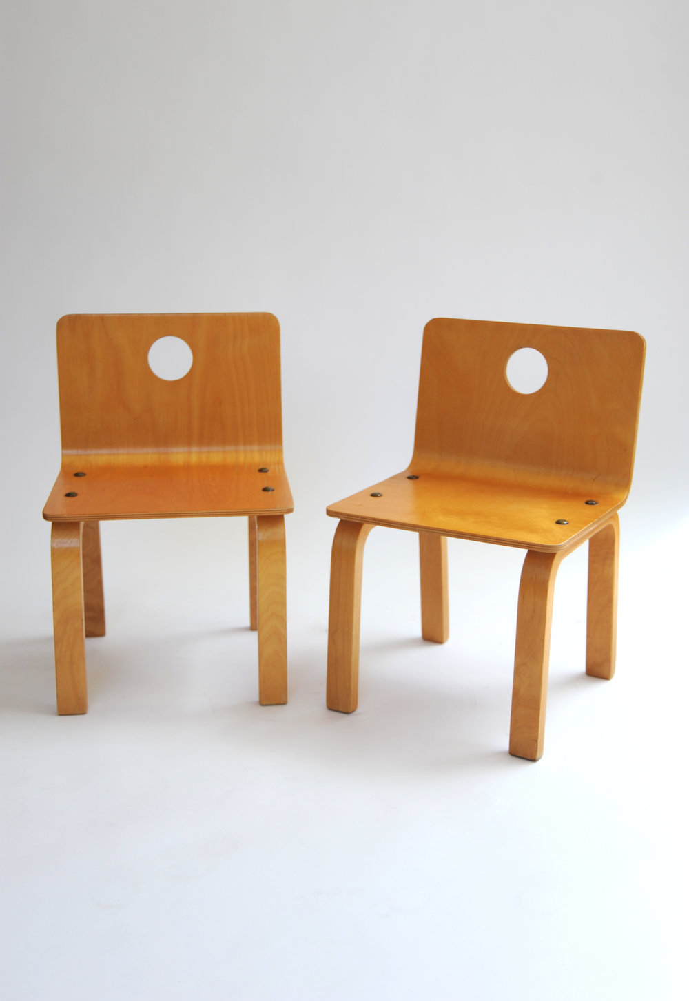 ALVAR AALTO STYLE CHILD CHAIR WITH CIRCLE-CUT OUT (Pair)    Attr. to Alvar Aalto    Finland, 1960s    Molded Ply    H 17 in, W 11.125 in, D 11 in (Seat: D 9.5 in) (Seat: H 9.5 in)    NOTES: 160 EUR (including shipping)    LIST PRICE: $650    DESIGNER DISCOUNT PRICE: $552.50    LEAD TIME: 3-5 Days Shipping & Handling     QUANTITY IN STOCK: 2    ONLINE PLATFORMS: KM WEB, ARTSY, 1ST DIBS