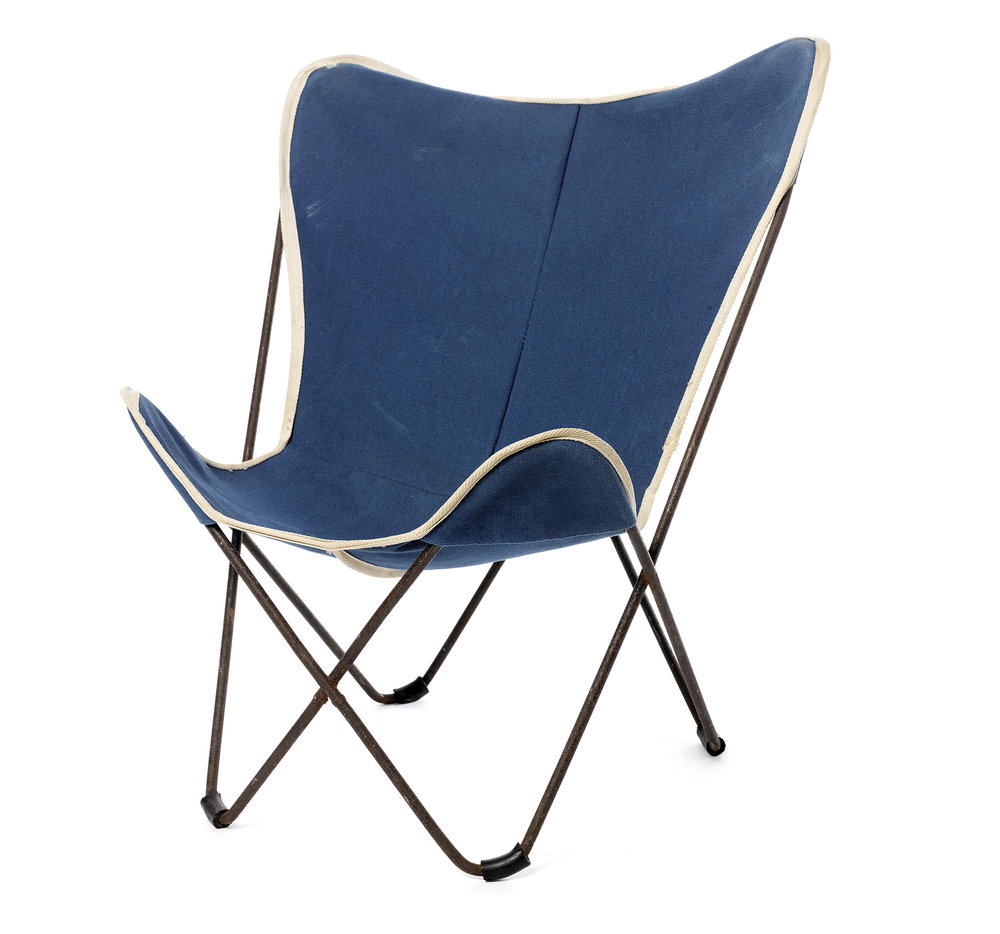 "Butterfly Chair Jorge Ferrari Hardoy, Antonio Bonet, Juan Kurchan circa 1930s iron, original blue canvas cover Seat H 10.5"" Back H 25"" W 17"" D 21.25 LIST PRICE: $175 DESIGNER DISCOUNT PRICE: $148.75 LEAD TIME: 3-5 Days Shipping & Handling QUANTITY IN STOCK: 1 ONLINE PLATFORMS: kM Web, Artsy"