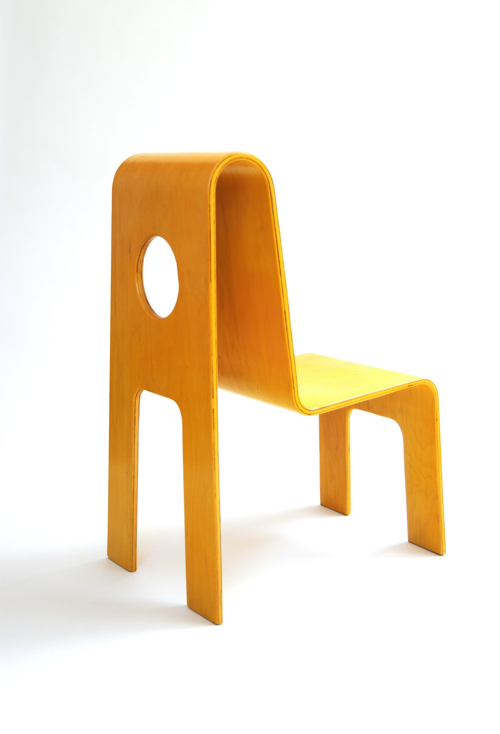 Yellow Cut Out Chair     I  sku Kinder-Link     Unknown Origin    Unknown Production    1990s     Bentwood select maple veneer with acrylic poly finish (water based pigment with clear top coat acrylic finish)      seat Back H 25 in, W 17 in, D 10.5 in, (Seat H: 12 in)     LIST PRICE:  $900     DESIGNER DISCOUNT PRICE:    LEAD TIME: 3-5 Days Shipping & Handling    QUANTITY IN STOCK: 1    ONLINE PLATFORMS: kM Web, Artsy