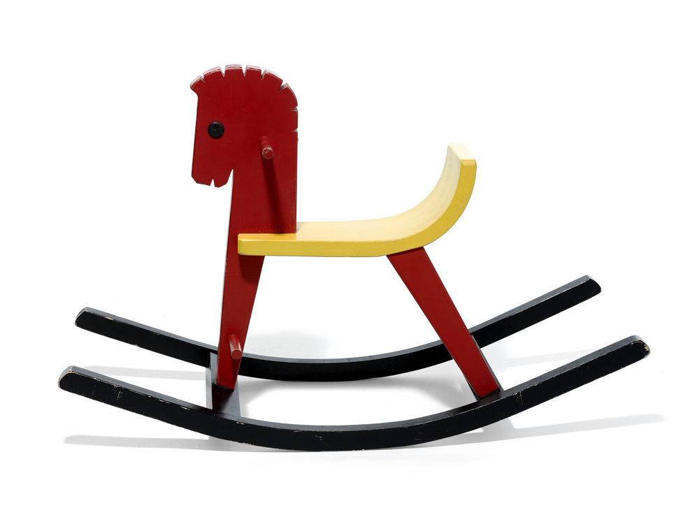 Konrad Keller Rocking Horse    Konrad Keller    Manufacturer: Konrad Keller Holzspielwaren    Germany     1950s      Red, yellow and black lacquered wood      H 21 in, W 12 in, L 33 in     LIST PRICE:  $685     DESIGNER DISCOUNT PRICE: $582.25    LEAD TIME: 12-14 Weeks    QUANTITY IN STOCK: 1    ONLINE PLATFORMS: kM Web, Artsy, 1st Dibs